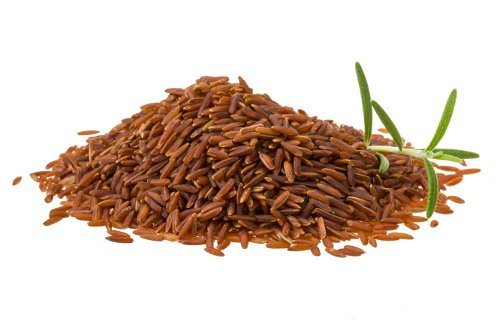 Heap of Brown rice isolated